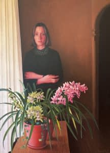 Oil painting by Josonia Palaitis depicting a weird looking woman standing awkwardly behing a vase full of orchids in flower