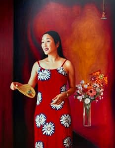An oil painting by Josonia Palaitis depicting Dr Cindy Pan wearing a red and white sleeveless dress holding a chinese fan standing next to a vase of mixed colourful flowers looking away from the viewer with an expression of happiness and hope with a rich red and orange background