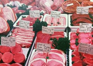 Oil painting by Josonia Palaitis depicting a close up display of meat cuts at a butcher's shop with price labels attached to skewers