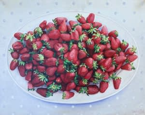 Photorealist oil painting by Josonia Palaitis depicting a large plate of strawberries placed on a white tablecloth viewed from directly above