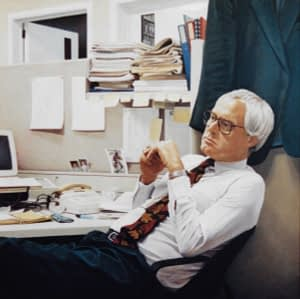 Oil painting by Josonia Palaitis depicting journalist Paul Lyneham leaning back in an office chair at his desk with lots of papers and stationery on the desk and on shelves with his jacket hanging behind him as he looks away from the viewer deep in thought wearing a white shirt and red toned tie